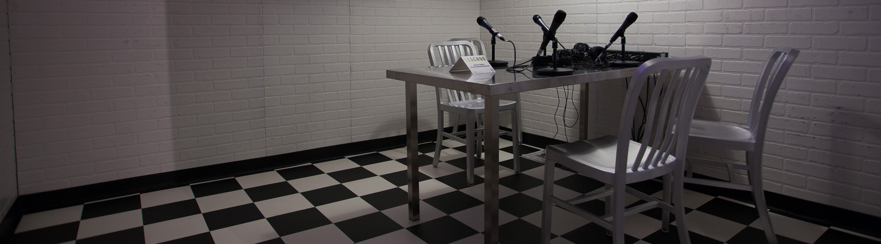 Custom set modeled after police interrogation rooms